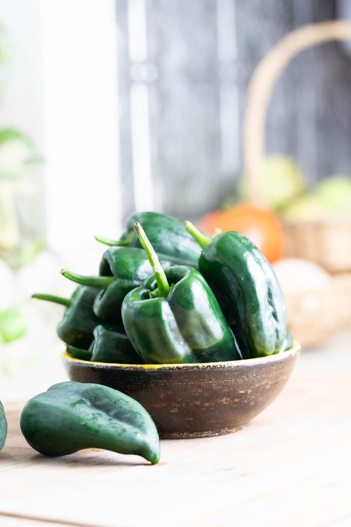 A bowl of freshly picked poblano peppers.