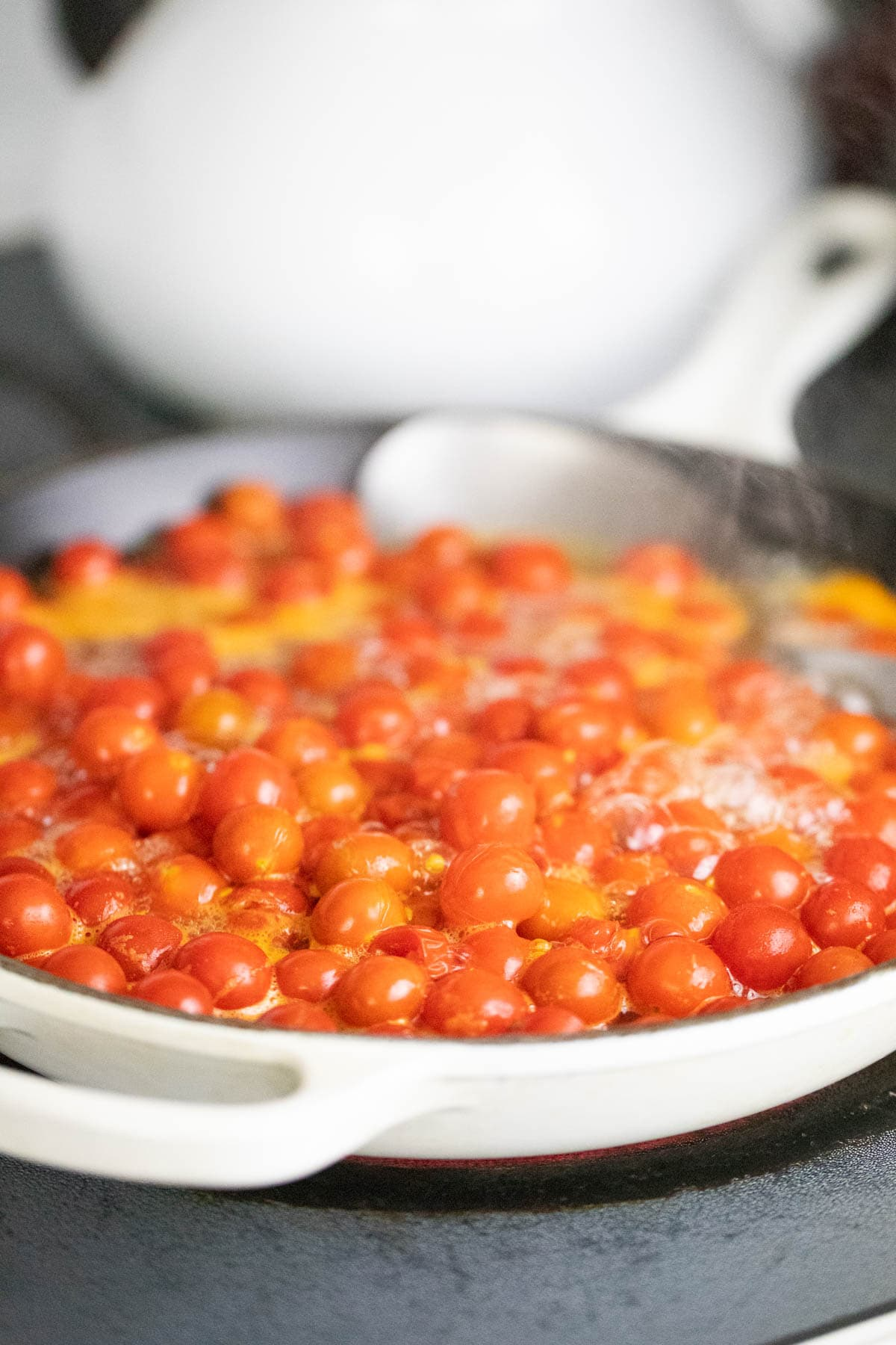 Boiling cherry tomatoes before canning.