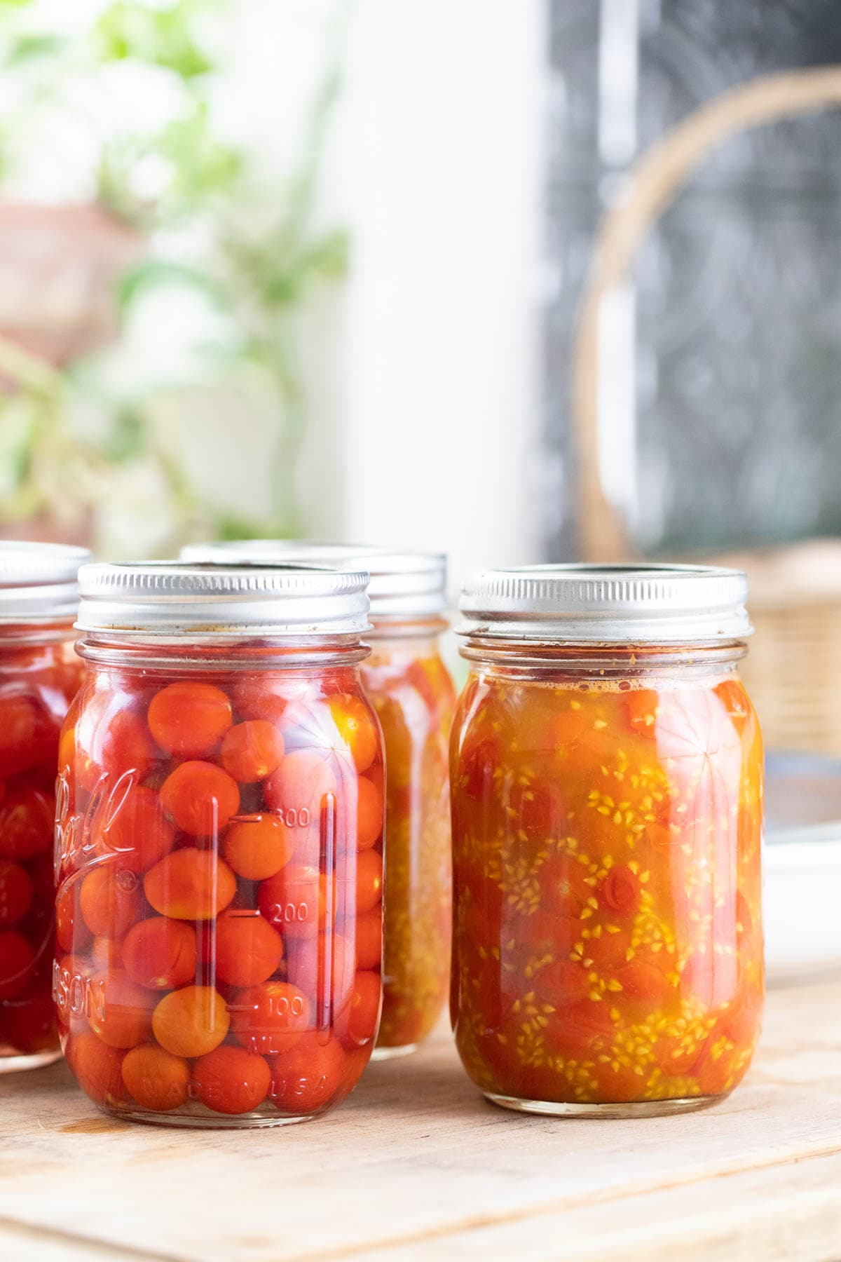 Canned cherry tomatoes ready for processing.
