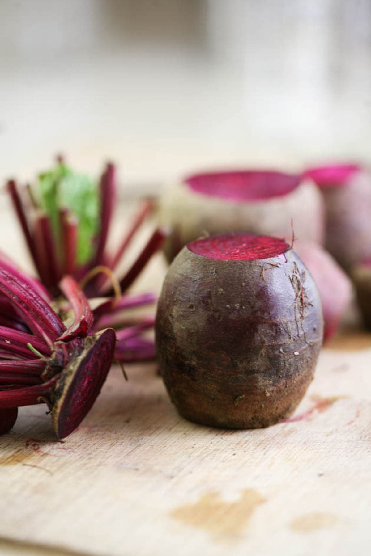 Cutting the tops and roots of the beets
