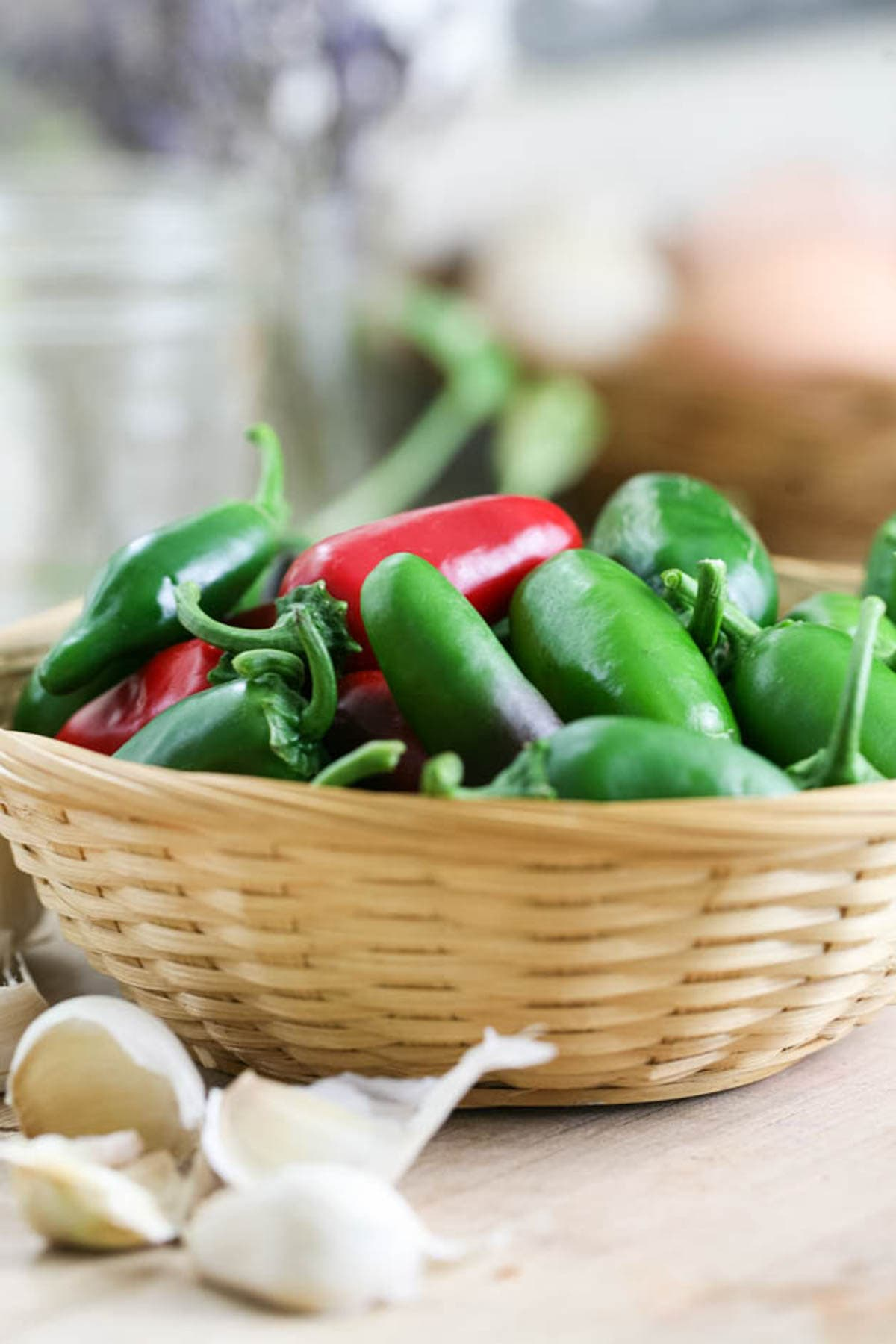 A basket of fresh jalapeno peppers.