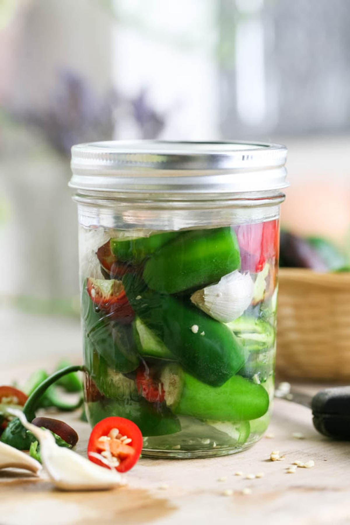 Lacto fermented jalapenos in a jar.