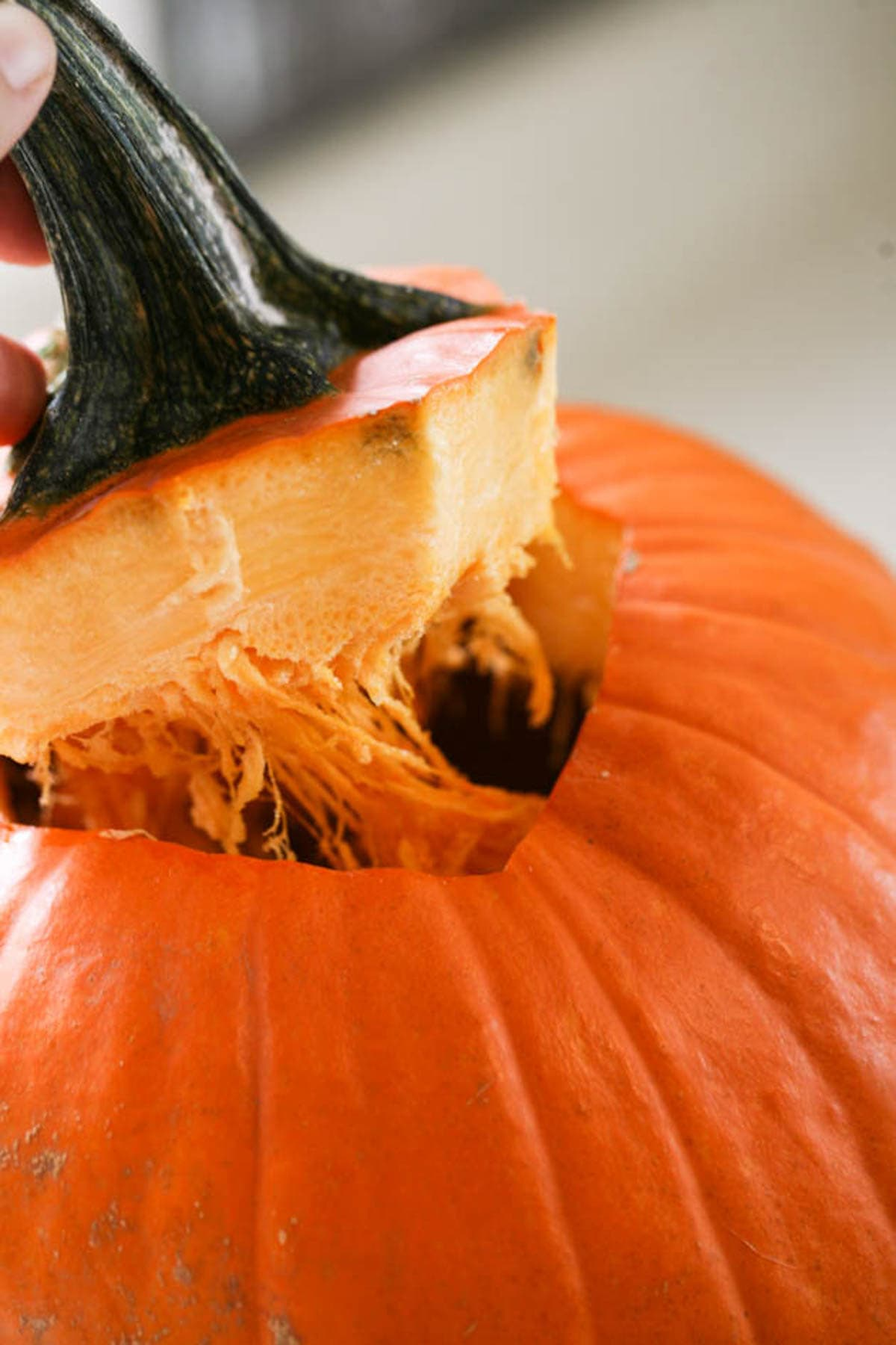 Removing the stem of the pumpkin.