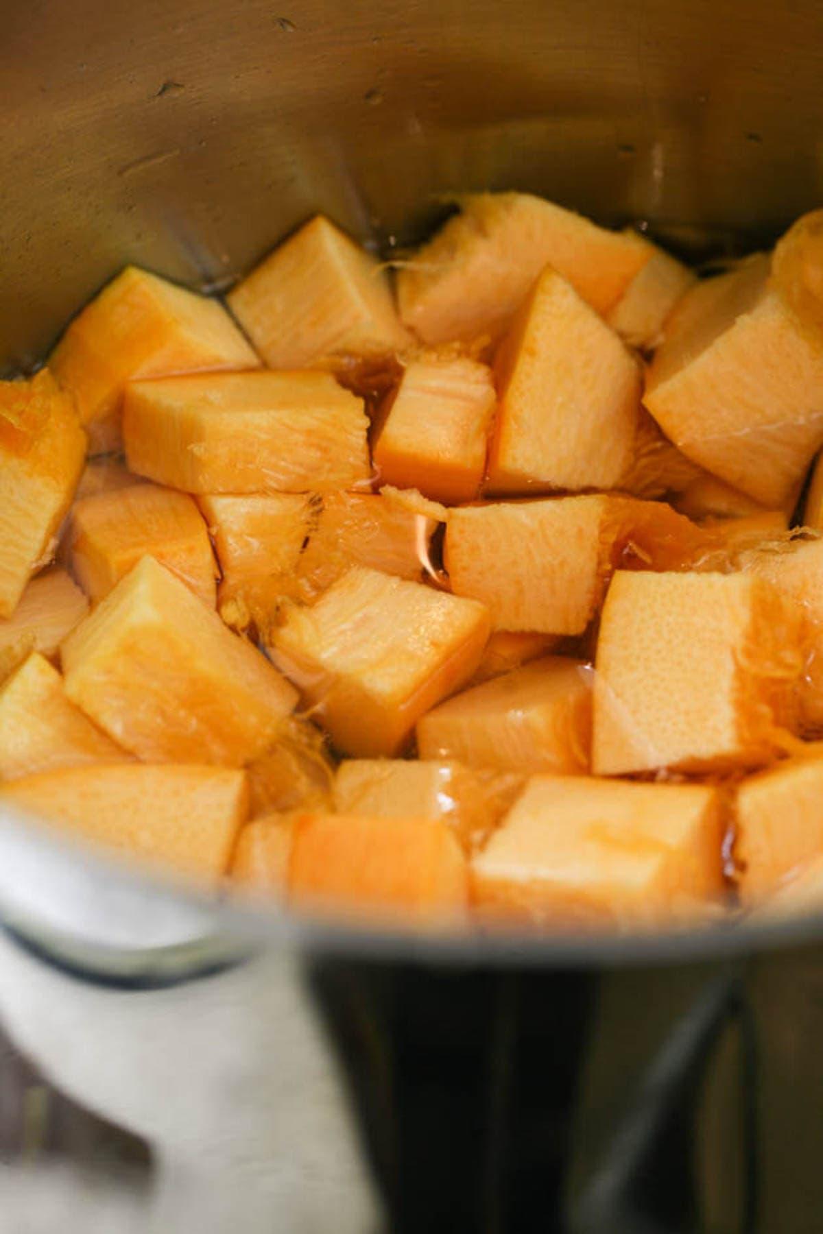 Boiling the pumpkin in water.