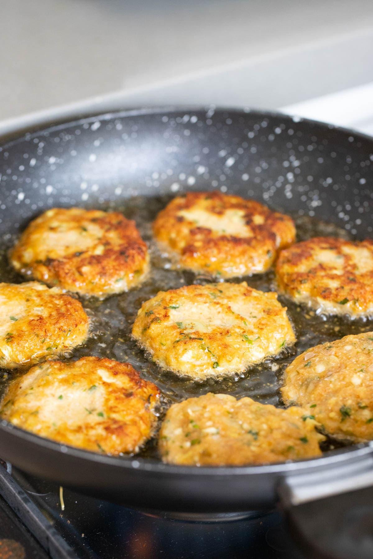 Frying the meatballs.